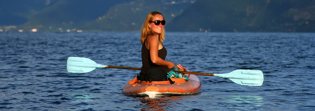 Woman in kayak pain free after acupuncture.